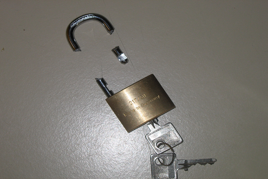 A+broken+lock+representing+bypassing+security.