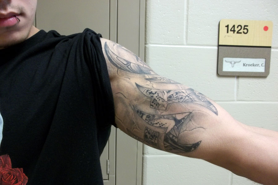 Edgar Garza shows off his tattoo of a tiger within a tribal flame.