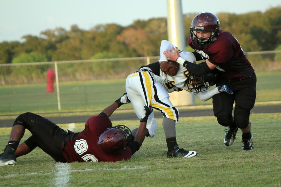 Number 32, Aaron Mcgee(Top) and Number 80, Christian Macias (Bottom) with the sack against Hastings