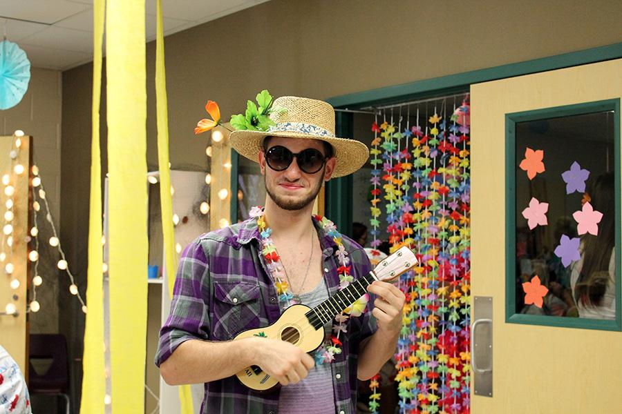 Senior Ryan Knoles really getting into the spirit of Hawaiian day, ukelele and all