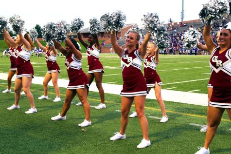 Cheerleading cheering for their school