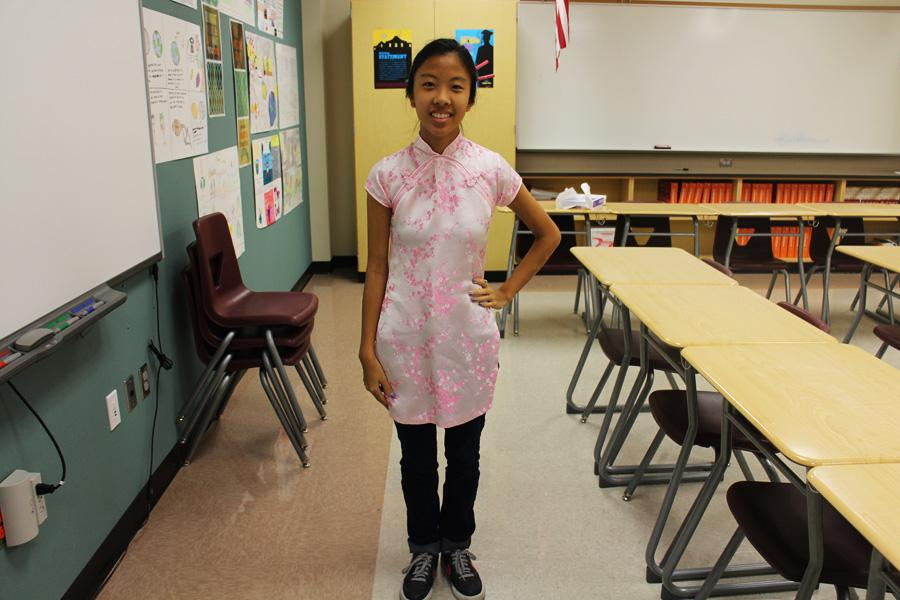 Ashley Cao in traditional Asian dress representing her culture.