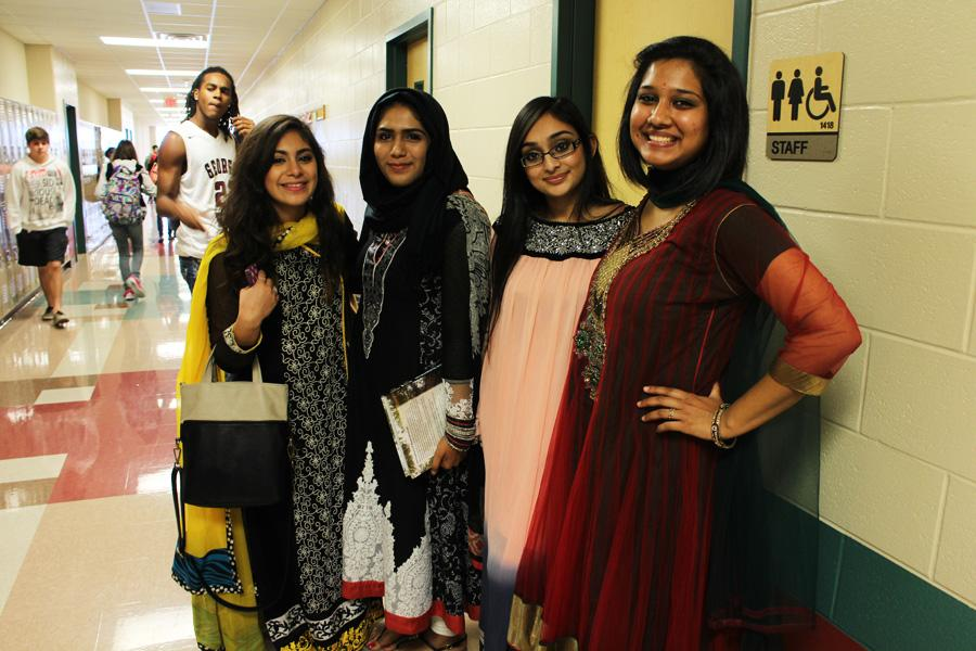 Rebecca Bonilla, Eman Hussain (two on left) and  Sunny Amin (far right) representing their Indian culture. Fatima Ghayour representing her Pakistani culture.