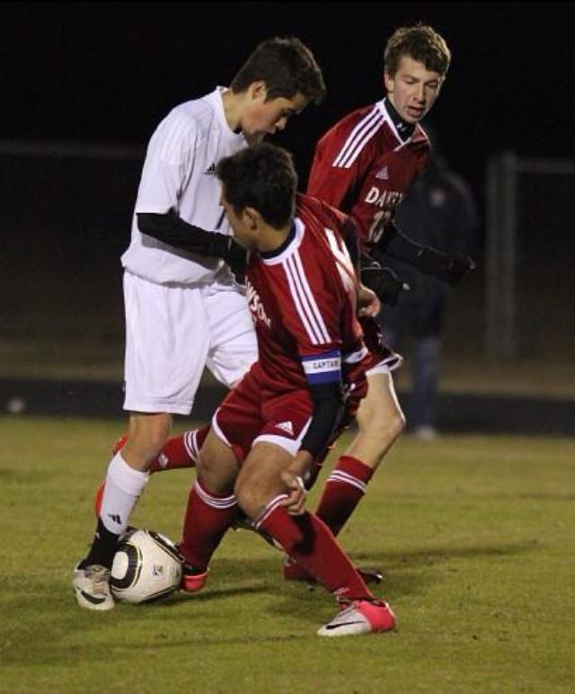 Matt+Vasquez+takes+on+two+defenders