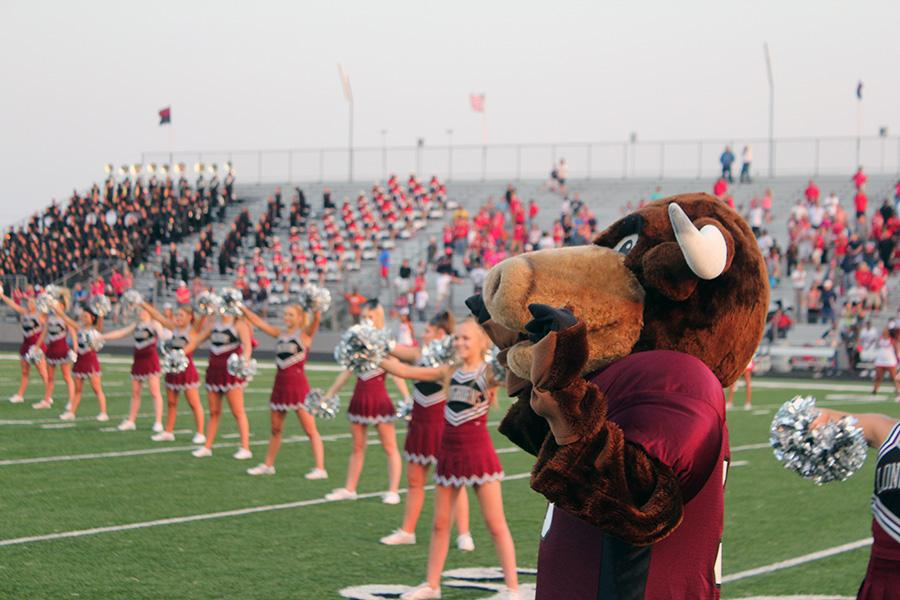 School Mascot and cheerleaders pump up the crowd before the game