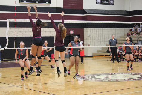 Kennedy Prince and Mattie Ward go up for a block.