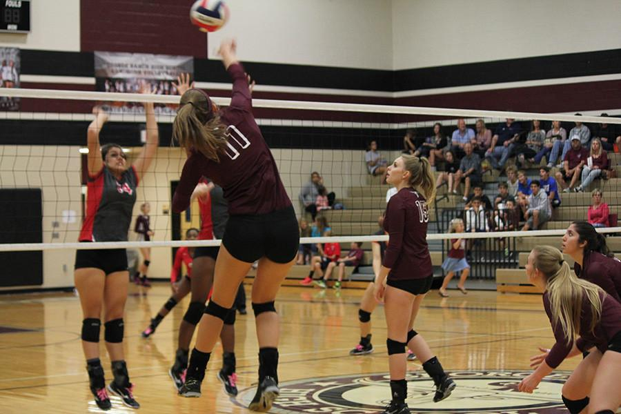 Ainsley Mandell successfully scores a point for her team with a kill.
