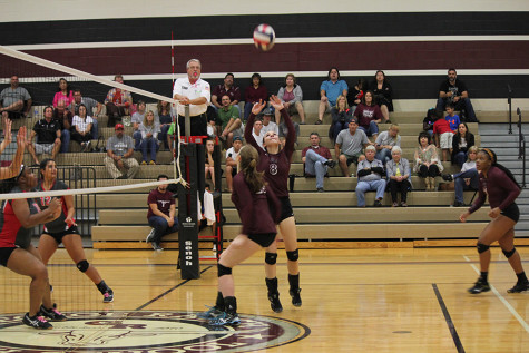 Abbey Messick sets a ball up for the left side.