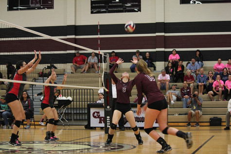Abbey Messick makes an assist and sets up her middle.