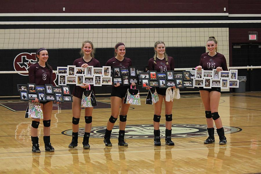 With tears in their eyes, the seniors from left to right Abbey Messick, Mattie Ward, Ainsley Mandell, Alyson Dernehl, and Ambrielle Logan pose for a photo holding a collage of all of their memories that George Ranch volleyball gave them.