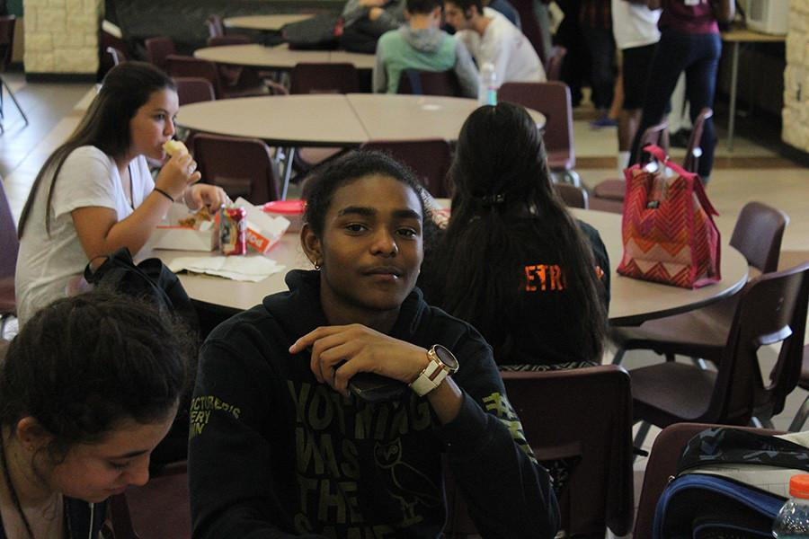student takes selfie at lunch