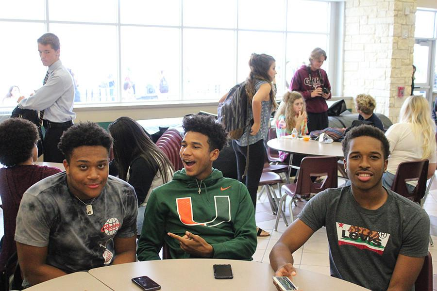 football players take a picture at lunch
