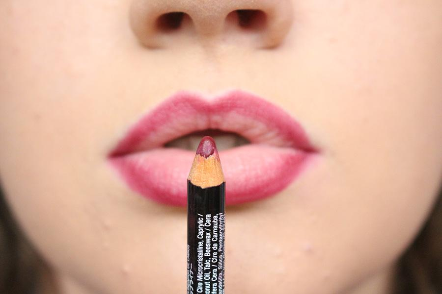 """Next, line your lips with a red lip liner, this one is the NYX Lip Liner in the shade """"Plum"""". Just go around the outside of your lips to prevent the lipstick from 'sliding' around."""