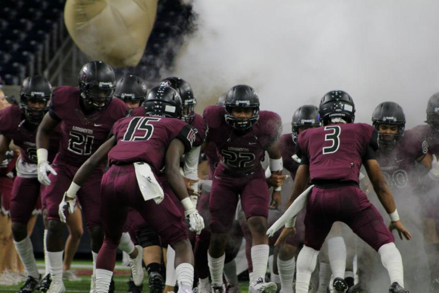 Behind, the smoke lies a great army, the GRHS Longhorns!