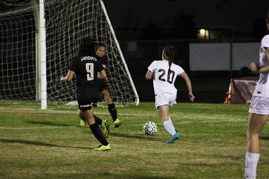 Sophomore Taylor Rech runs toward the goal in hopes of scoring