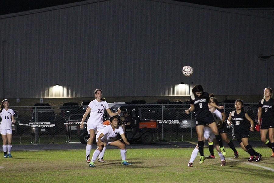 Freshman Celeste Ruiz bends down in preparation to head the ball