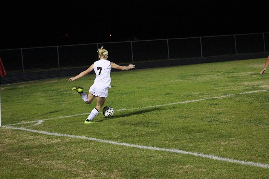 Junior Gabby Galvan attempts to launch the ball across the field towards the goal