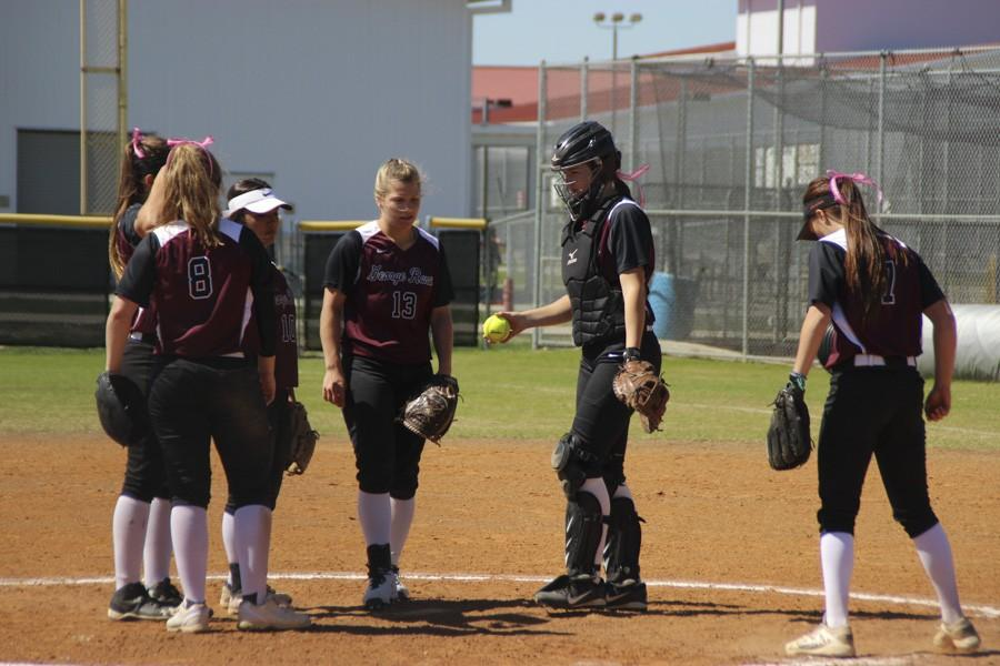 The team gathers before the inning begins.