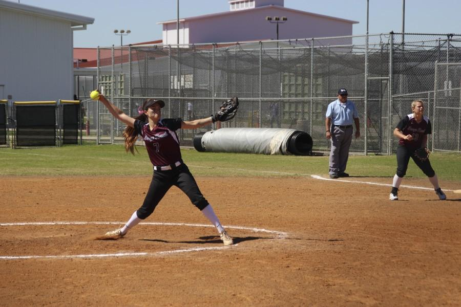 Lexi Tovar powerfully extends for her pitch.