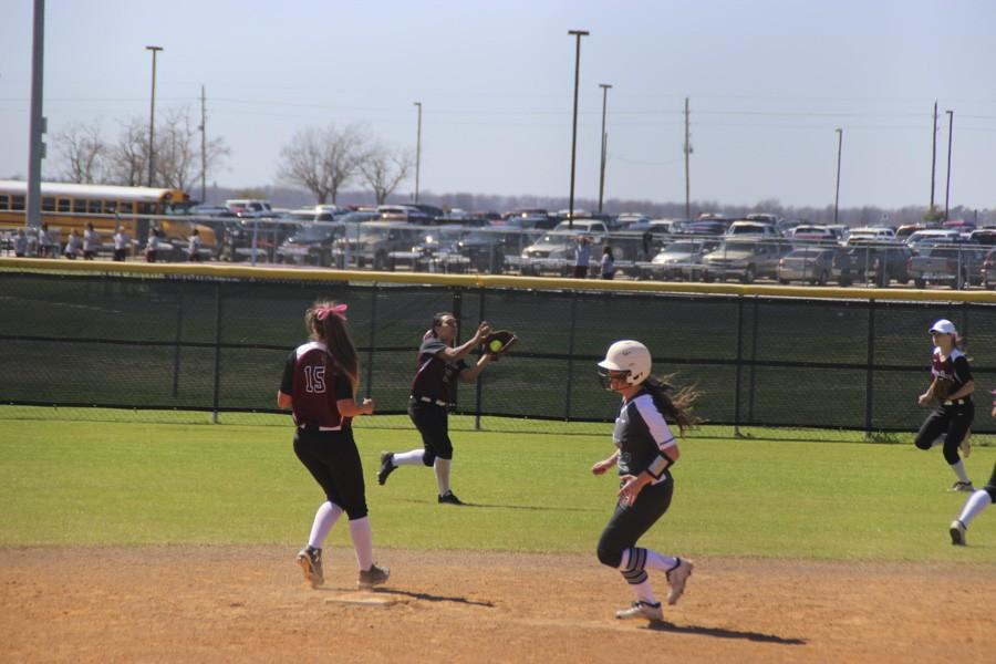 Kayte Martinez catches a pop-up to center field.