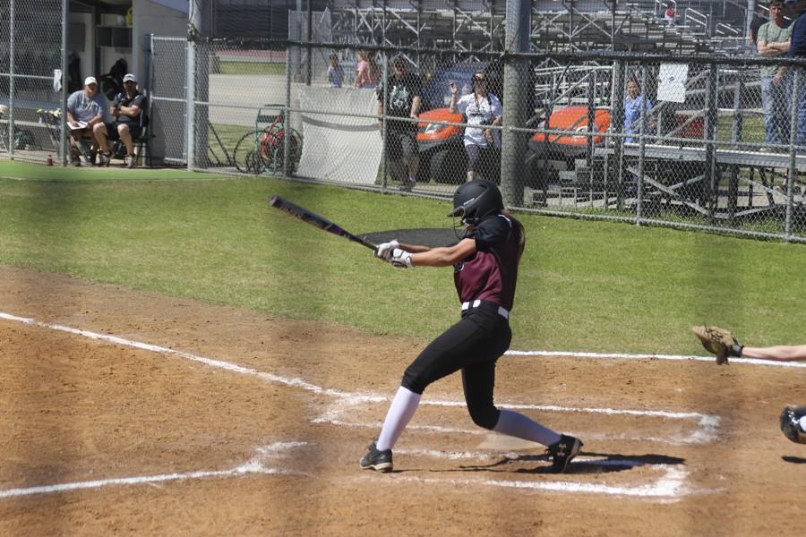 Destiny Walker extends a powerful swing.