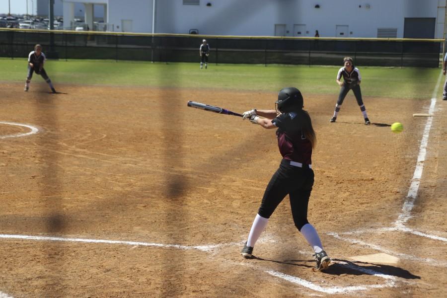 Destiny Walker swings at a rise ball.