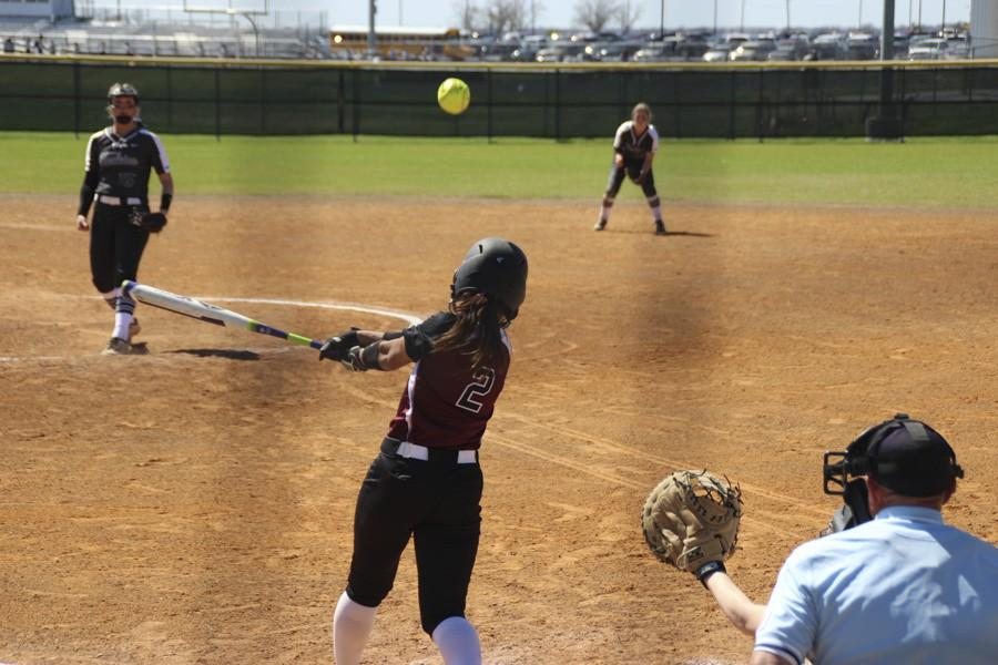Lily Pearson hits a line drive to center field.