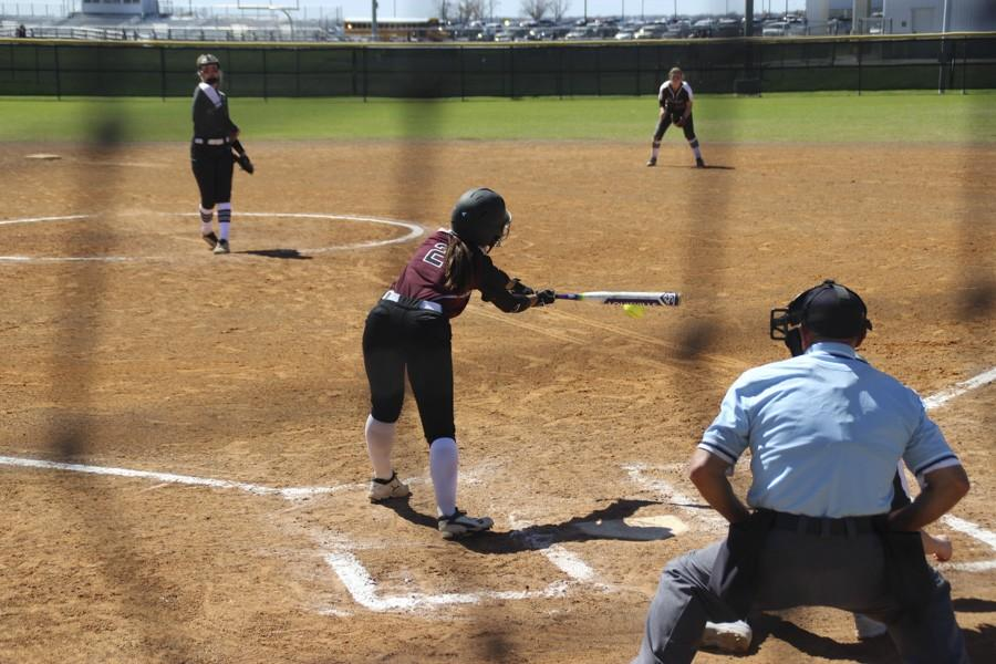 Lily Pearson stretches to reach a curve ball that's off the plate.
