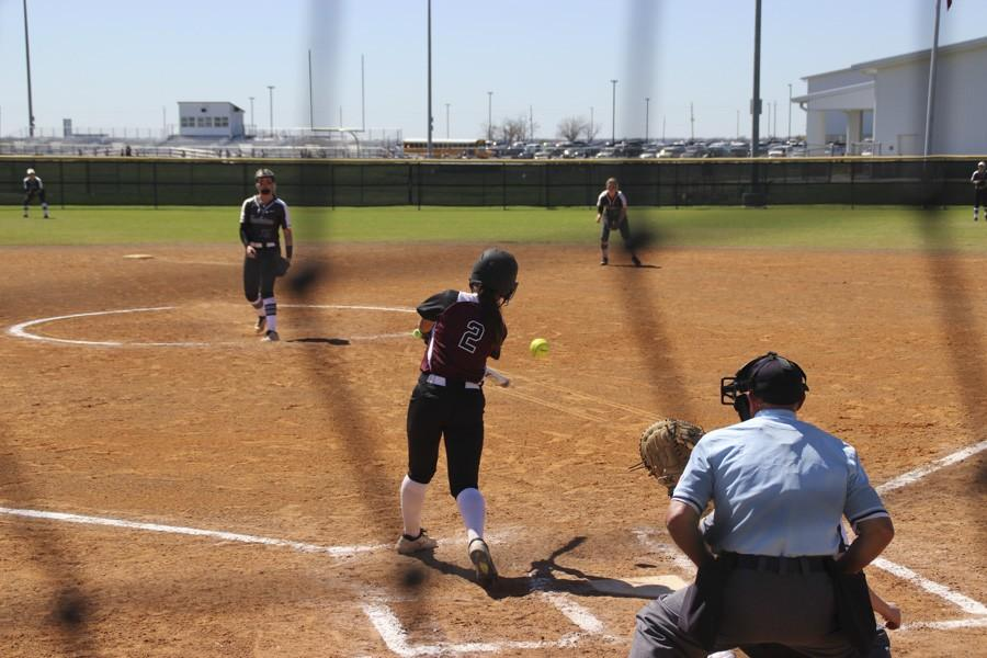 Lily Pearson swings at a fast ball.