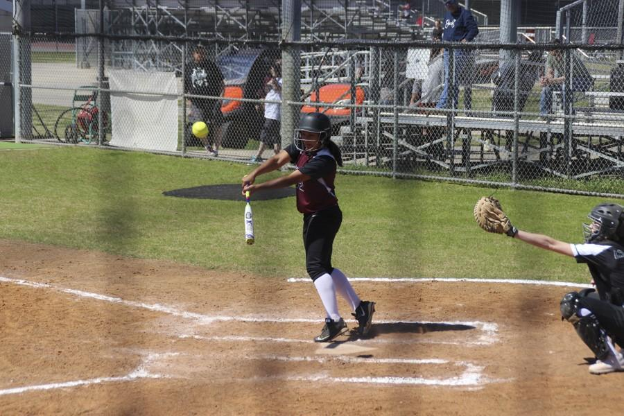 Kayte Martinez launches a ball back at the pitcher.