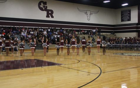 The Lariettes stand in lines and get ready to introduce the Varsity Volleyball girls into the gym.