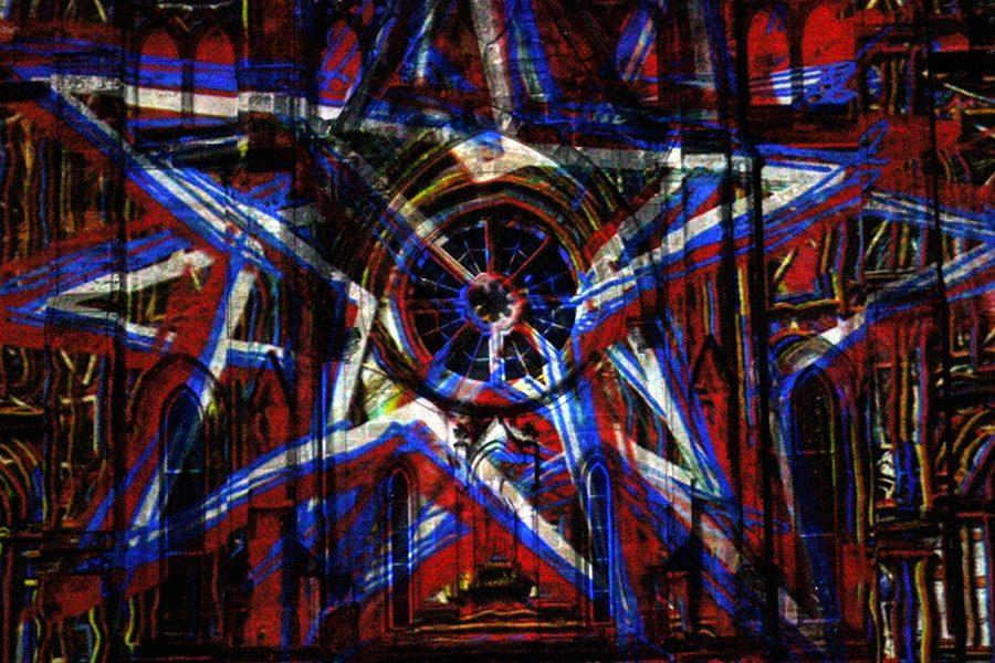 Stars appearing in red, white, and blue on a San Antonio Cathedral