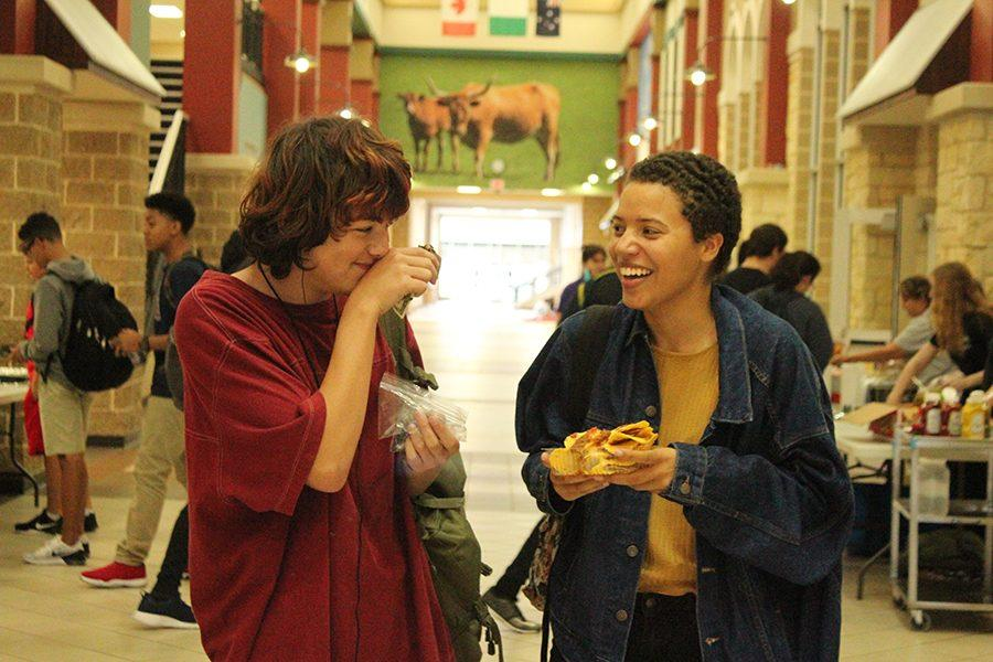 Nathan Chong and Jadelyn Bryan, a couple, laugh about the awkwardness while eating nachos.