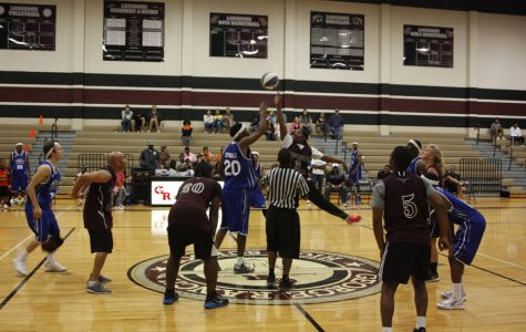 Two players fight for the ball during the tip-off.