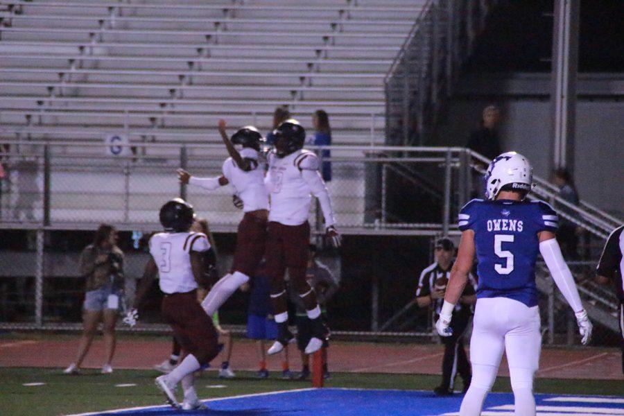 Antonio Jackson, and Quinton Morris celebrate the touchdown.