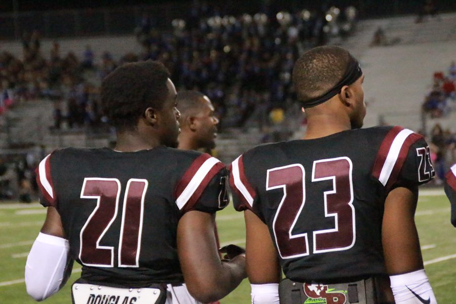 Brent Ugo and Samuel Barnes watch from the sidelines as the game comes to an end.