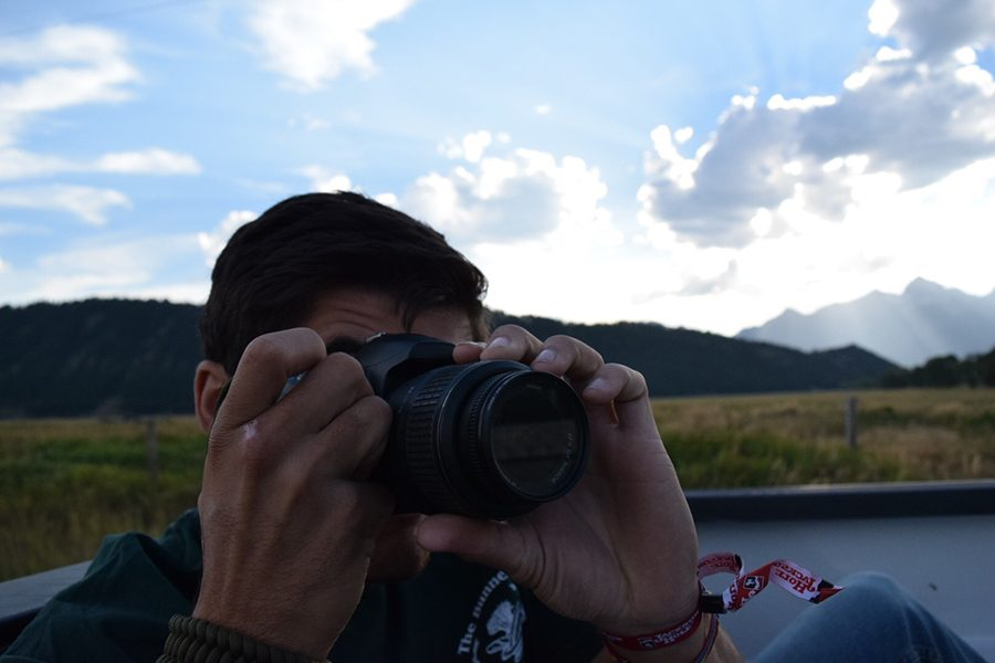 Nicholas Castillo taking a picture in Jackson Hole, Wyoming.