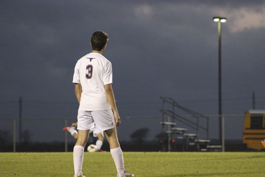 Number 3 waits for the ball and stays in his zone.