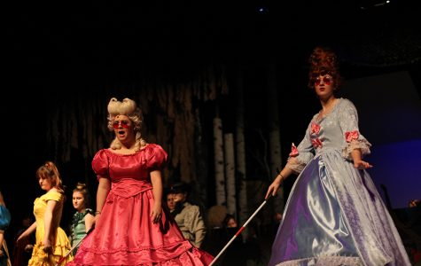 The blind stepsisters stumble around the wedding, trying to get in Cinderella's good graces since she is now royalty.