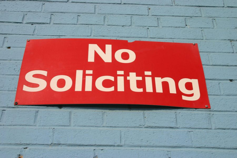 A No Soliciting sign on a wall.