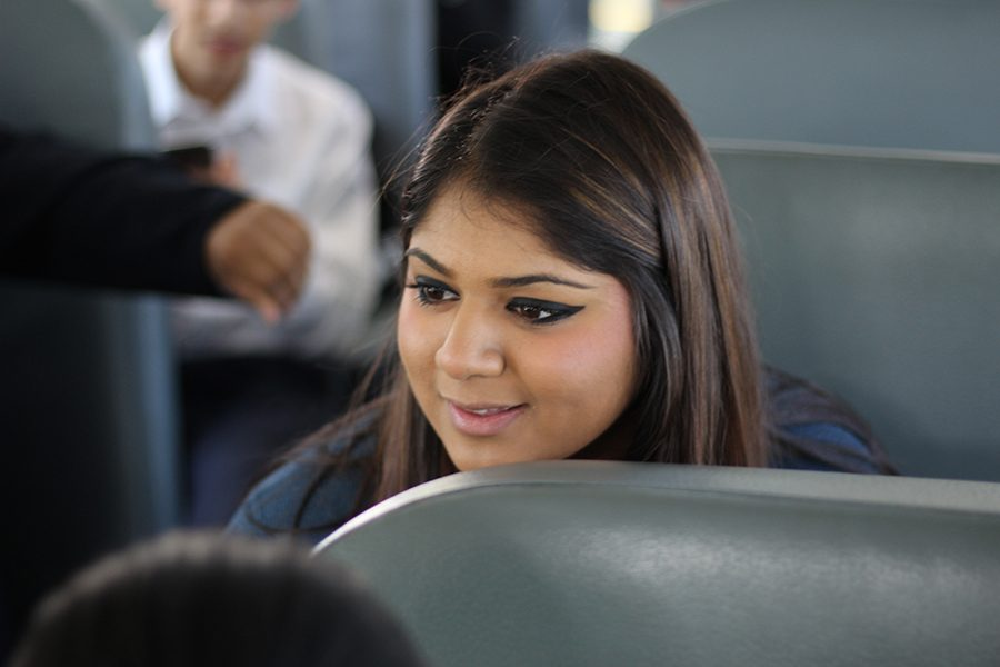 Aisha Sheikh, president of the speech and debate team, getting the team prepared on the way to Houston Lamar.
