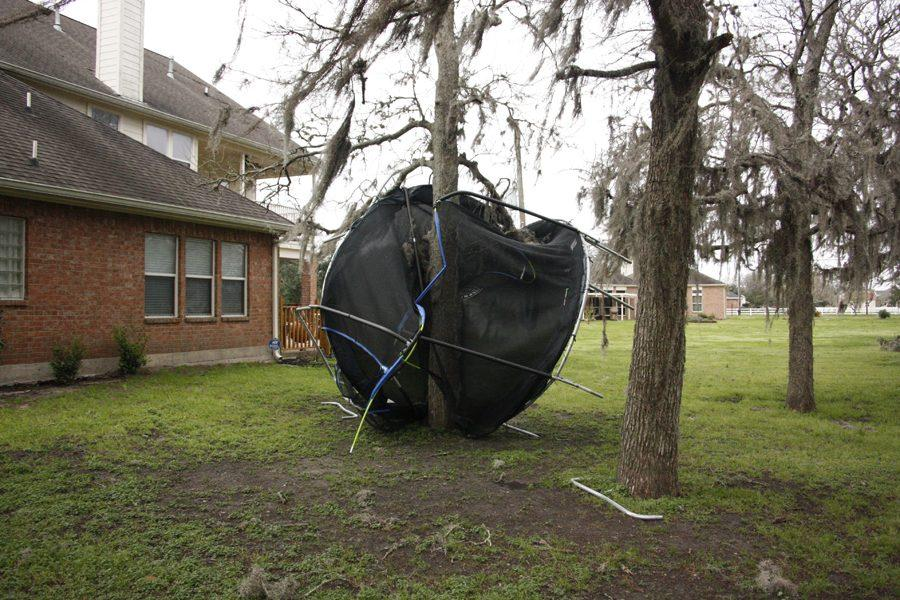 Trampoline blown into tree.
