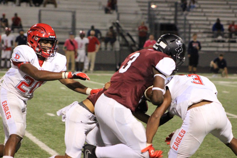 David Fisher runs over the defender for some extra yards.