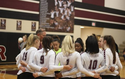 Coach Reeves and the girls discussing the game.