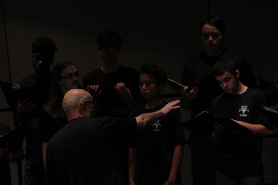 The Choir Director, Doctor Johnson, directed the choir and the audience on how to control their voices when singing.