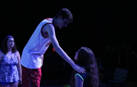 Eric May (Jesus) extends his hand onto a follower's (Paige Klase) shoulder