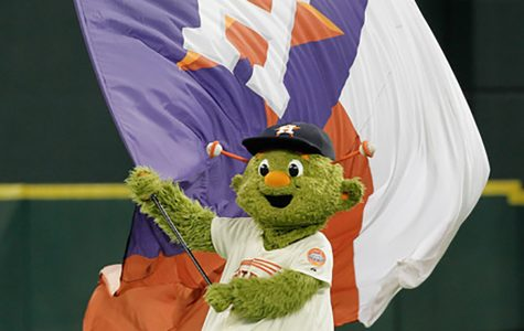 Astros' mascot orbit waves the victory flag after an Astros win
