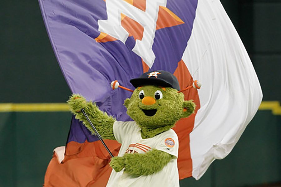 Astros%27+mascot+orbit+waves+the+victory+flag+after+an+Astros+win