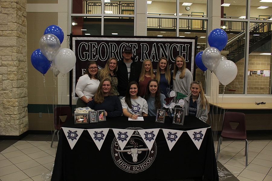 Lexie Shafer hanging out with her friends at the signing table.