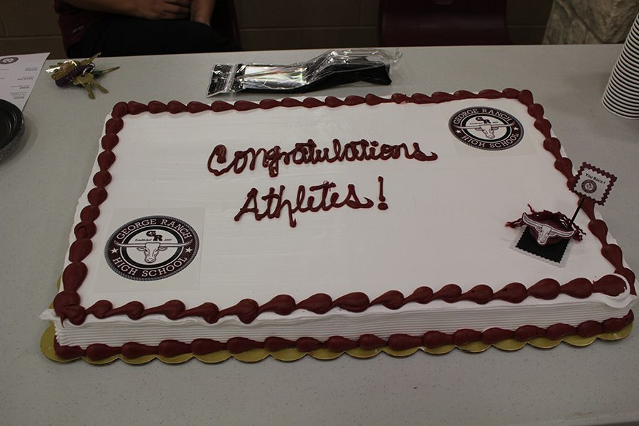 Lets eat some cake as we celebrate our athletes.